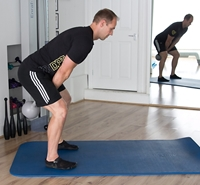 double-arm-kettlebell-swing-southfields-physiotherapy